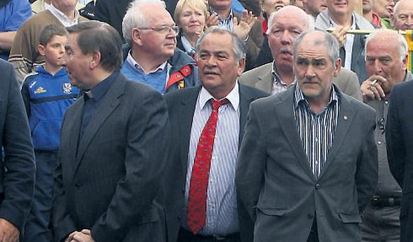 Eamon Devlin (centre) at a rally in support of Sean Quinn in Ballyconnell, Co Cavan, in July. Also at the rally were Father Brian D'Arcy and Micky Harte