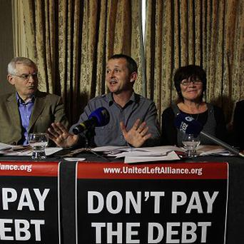 United Left Alliance TD Richard Boyd Barrett, second left, launches the alternative budget with colleagues at Buswell's Hotel in Dublin