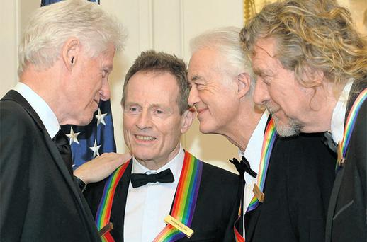 Bill Clinton (left) talks to ex-Led Zeppelin members John Paul Jones, Jimmy Page and Robert Plant (right).