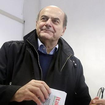 Pier Luigi Bersani casts his vote during a primary runoff, in Piacenza (AP)