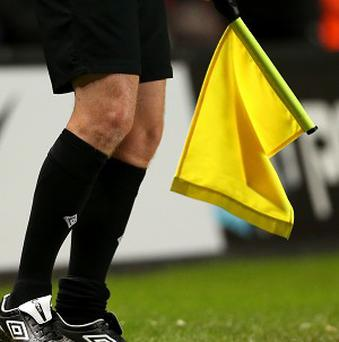 A Dutch assistant referee has died after being attacked by players