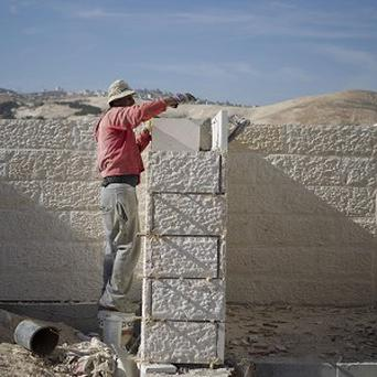 The UK has urged Israel to drop plans to build 3,000 new homes in the West Bank and East Jerusalem