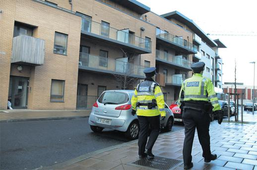 Gardai on patrol outside the apartment block in Rialto, Dublin, where Thomas Heinrich was stabbed to death