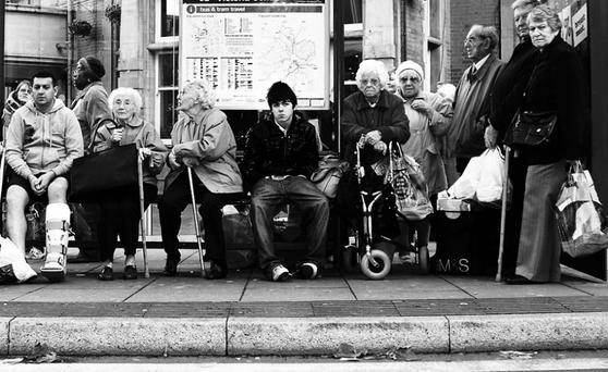Bus Stop by Stephen Wright, UK, who says: I noticed 99 percent of which were elderly or infirm/disabled in some way, except the young boy in the middle, who refuses to give up his seat.