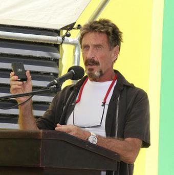 John McAfee speaks at the San Pedro Police Station in Ambergris Caye, Belize (AP/Ambergris Today Online-Sofia Munoz)