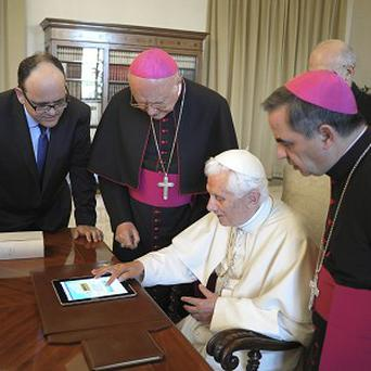 The pope gets some IT training (AP)