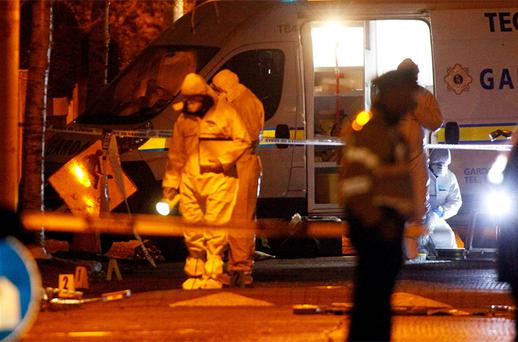 Garda Forensics pictured working at the scene of The Eamonn Kelly fatal shooting at Furry Park, Killester last night. Photo: Colin O'Riordan
