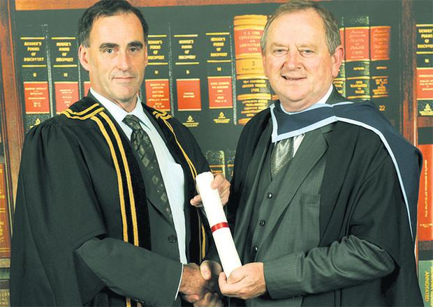 Former councillor Flan Garvey receives his degree from Michael Carmody, president of Institute of Technology Tralee, in 2008