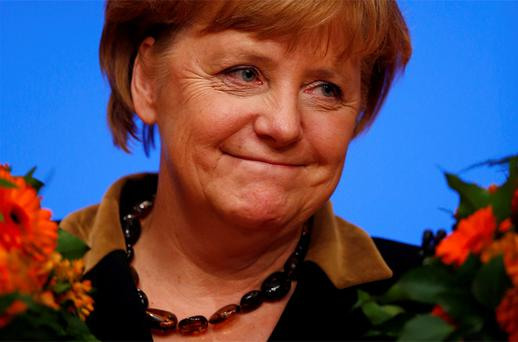 Angela Merkel reacts after her re-election as party leader during the CDU's annual party meeting in Hanover. Photo: Reuters