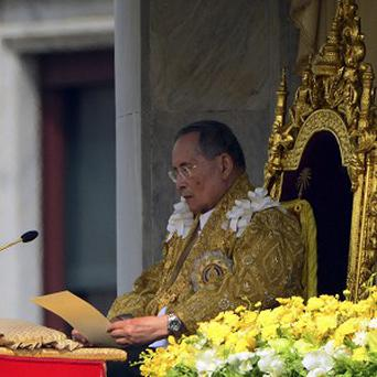 Thailand's King Bhumibol Adulyadej addresses the crowd during his 85th birthday celebration (AP)