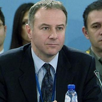 Serbia's ambassador to Nato Branislav Milinkovic died in a fall from an airport building (AP)