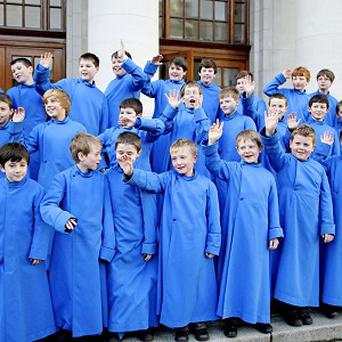 Members of the Palestrina Choir celebrate on the steps of Government Buildings in Dublin being asked to perform for the Pope