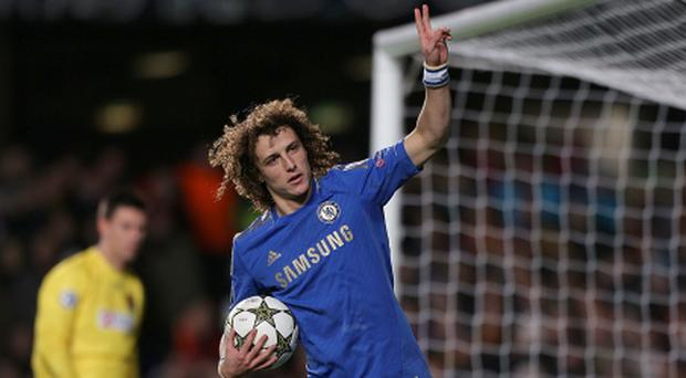 Chelsea's David Luiz celebrates after scoring his team's opening goal from the penalty spot during the UEFA Champions League match at Stamford Bridge, London. PRESS ASSOCIATION Photo. Picture date: Wednesday December 5, 2012. See PA story SOCCER Chelsea. Photo credit should read: Nick Potts/PA Wire.