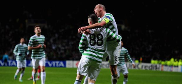 GLASGOW, SCOTLAND - DECEMBER 05: Celtic striker Gary Hooper celebrates after scoring the first goal with Scott Brown (r) during the UEFA Champions League Group G match between Celtic FC and FC Spartak Moscow at Celtic Park on December 5, 2012 in Glasgow, Scotland. (Photo by Stu Forster/Getty Images)