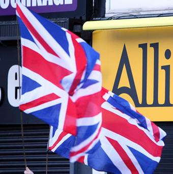 A row over flying the Union Jack on Belfast City Hall has sparked violence in Carrickfergus