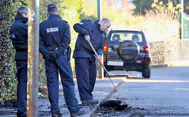 Gardai in Clontarf where a burnt-out car was found after the fatal shooting of Eamon Kelly in Killester