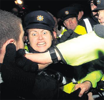 Protesters clash with gardai outside Leinster House in the wake of the Budget