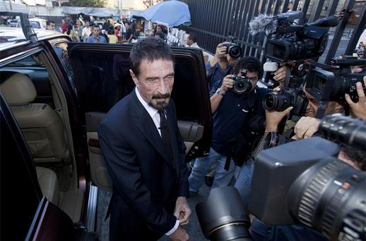 Software company founder John McAfee poses for pictures after a press conference outside the Supreme Court in Guatemala City. Photo: AP