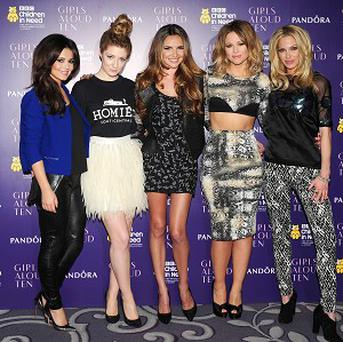 Cheryl Cole dons nightwear for the latest Girls Aloud video, while Nadine Coyle is seen in the bath