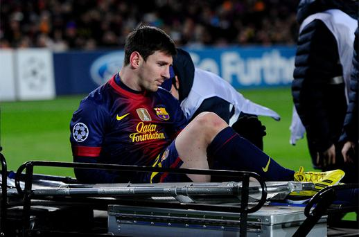 Lionel Messi of FC Barcelona leaves the pitch on a stretcher after being injured during the UEFA Champions League Group G match between FC Barcelona and SL Benfica at Nou Camp. Photo: Getty Images