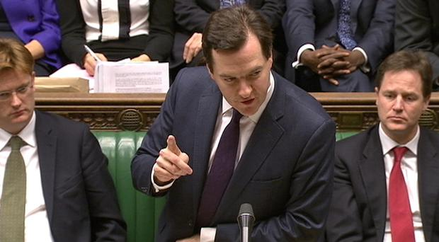 Britain's Chancellor of the Exchequer George Osborne delivers his autumn budget in parliament. Photo: Reuters