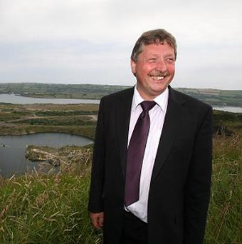 Sammy Wilson is concerned the executive could be left with a multimillion-pound bill for a new cross-border bridge
