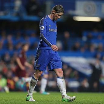 Rafael Benitez believes Fernando Torres, pictured, provides Chelsea with useful defensive qualities at corners
