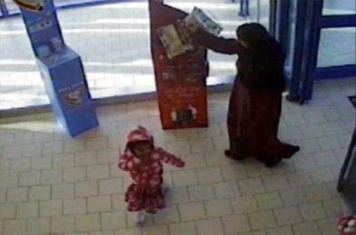 Three-year-old Mariam Alam with her mother as they entered Lidl supermarket in John Wigley Way, Coventry on November 30. Photo: PA