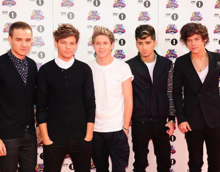 File photo dated 07/10/2012 of One Direction, as the boy band will release a debut signature fragrance this summer as they enjoy soaring success. PRESS ASSOCIATION Photo. Issue date: Sunday December 2, 2012. The pop sensations, who have sold over 17 million records globally, will launch the scent as the first in a collection of One Direction fragrances. See PA story SHOWBIZ OneDirection. Photo credit should read: Ian West/PA Wire
