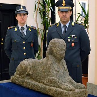 An Egyptian sphinx confiscated by police from a greenhouse near Rome (AP/Courtesy of Italian Finance Police)