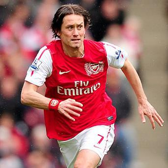 Returning midfielder Tomas Rosicky is keen for Arsenal to adopt a quicker tempo
