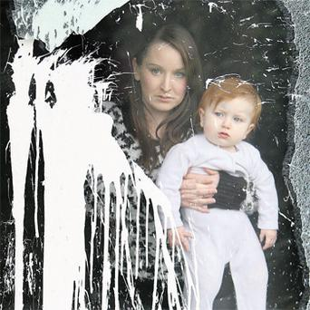 Alliance Party councillor Christine Bower, with her daughter Grace, at their home in Bangor, Co Down, which was attacked with paint bombs. Photo: PA