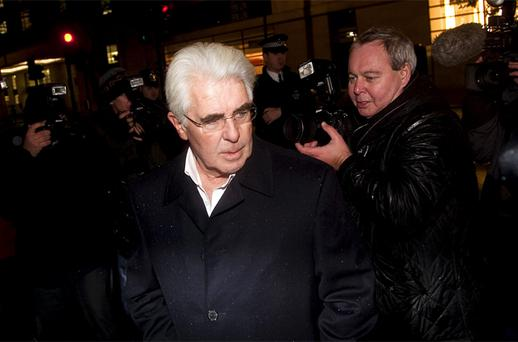 Max Clifford leaving the police station
