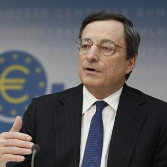 Mario Draghi speaks during a press conference in Frankfurt, central Germany (AP)