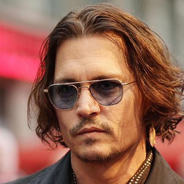 Johnny Depp performed with Aerosmith during a gig in LA