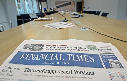 Copies of FTD lie on a table in the empty conference room during the last working-day of the newspaper in Hamburg. Photo: Reuters