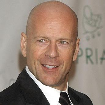 Bruce Willis has been voted the male Hollywood action hero best placed to save humanity from the brink of disaster