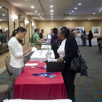A woman fills out an application at the Fort Lauderdale Career Fair in Dania Beach, Florida (AP)