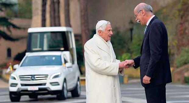 Daimler chief executive, Dieter Zetsche, personally hands over to Pope Benedict the keys to his new Mercedes-Benz car.