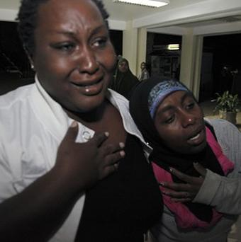 Relatives cry for their loved one as he is brought into hospital after an explosion in Nairobi, Kenya (AP)
