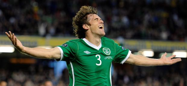Ireland's Kevin Kilbane celebrates a goal for his country