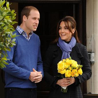 The Duke and Duchess of Cambridge leave the King Edward VII hospital in London, where she was treated for severe morning sickness