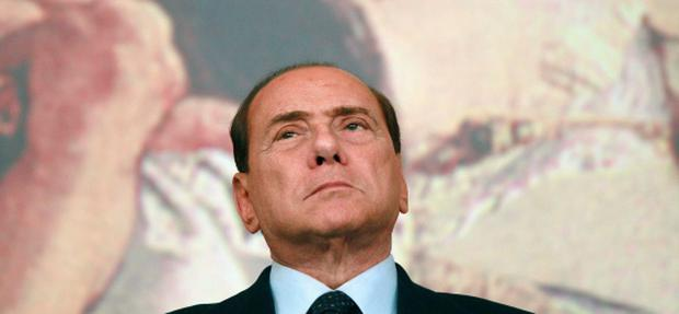 Then Italy's Prime Minister Silvio Berlusconi looks up during a news conference at Chigi Palace in Rome in this August 4, 2011 file photo. Five years after he won one of Italy's biggest postwar election victories, Berlusconi is dragging his own party towards destruction by a mixture of indecision and refusal to withdraw gracefully. REUTERS/Tony Gentile/Files (ITALY - Tags: POLITICS)
