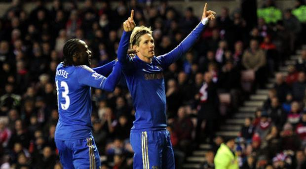 Chelsea's Fernando Torres celebrates his second goal of the game during the Barclays Premier League match at the Stadium of Light, Sunderland. PRESS ASSOCIATION Photo. Picture date: Saturday December 8, 2012. See PA Story SOCCER Sunderland. Photo credit should read: Owen Humphreys/PA Wire. RESTRICTIONS: Editorial use only. Maximum 45 images during a match. No video emulation or promotion as 'live'. No use in games, competitions, merchandise, betting or single club/player services. No use with unofficial audio, video, data, fixtures or club/league logos.