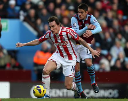 Stoke City's Dean Whitehead is challenged by Aston Villa's Ashley Westwood during the Barclays Premier League match at Villa Park, Birmingham. PRESS ASSOCIATION Photo. Picture date: Saturday December 8, 2012. See PA Story SOCCER Villa. Photo credit should read: David Davies/PA Wire. RESTRICTIONS: Editorial use only. Maximum 45 images during a match. No video emulation or promotion as 'live'. No use in games, competitions, merchandise, betting or single club/player services. No use with unofficial audio, video, data, fixtures or club/league logos.