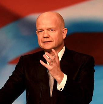 William Hague warned that Bashar Assad's regime would face action if they deployed chemical weapons against rebels