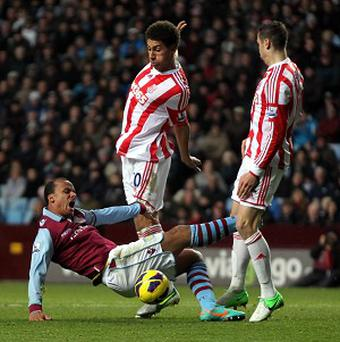 Ryan Shotton, centre, was sent off late in the game as Stoke and Aston Villa drew