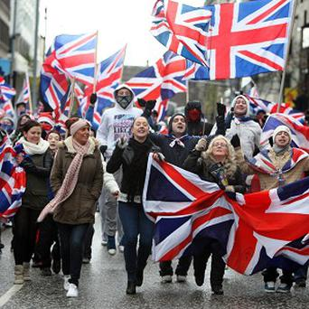 Loyalists protest against new restrictions on flying the Union flag in Belfast city centre. (PA)