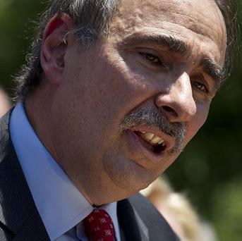 David Axelrod had his trademark moustache shaved in the name of charity (AP)