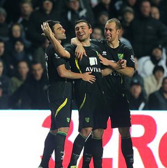 Robert Snodgrass, centre, made sure of Norwich's win with an excellent free-kick